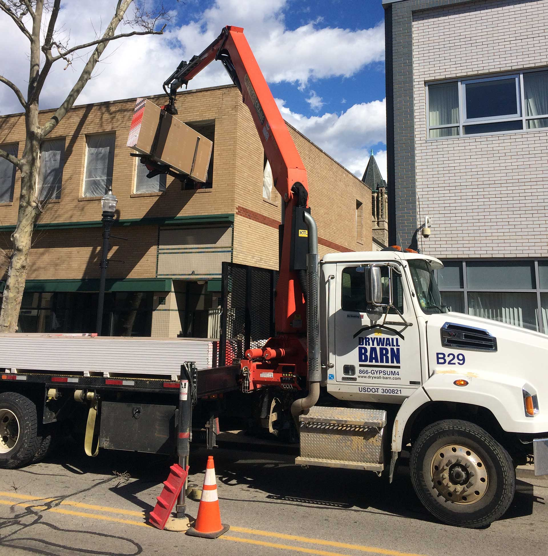 Drywall Barn Boom Truck Delivering Second Story